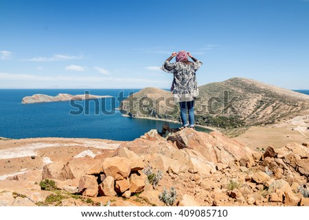 Tourist on Isla del Sol, Lake Titicaca, Bolivia - stock photo