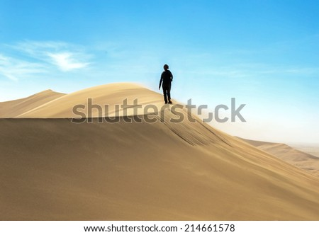 Tourist on the slope of the Dune 7 in Sossusvlei plato of Namib Naukluft National Park - Namibia, South-West Africa