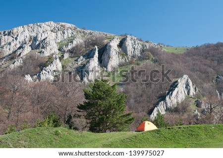 Tourist orange tent in mountains. Crimea