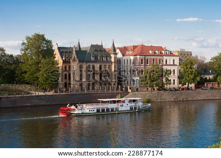 tourist ship at the river Odra, Wroclaw, Poland  - stock photo