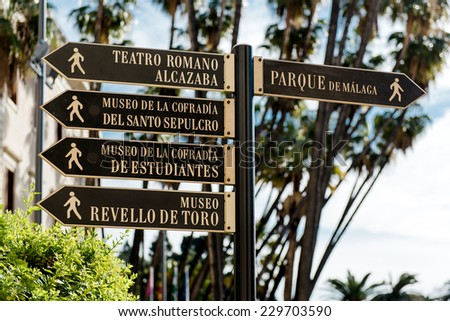 Tourist signpost in Malaga. Andalusia, Spain  - stock photo