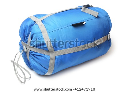 Tourist sleeping bag in a compression bag on white background - stock photo