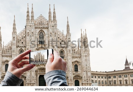 Tourist taking a picture of Milan Cathedral, Duomo at Piazza del Duomo. Italy - stock photo