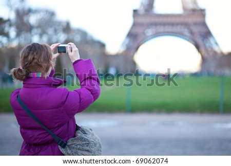 Tourist taking a picture of the Eiffel Tower - stock photo