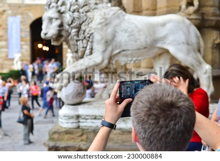 tourist taking picture - stock photo
