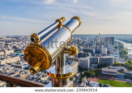 Tourist telescope in the Eiffel tower for viewing the city of Paris and river Seine - stock photo