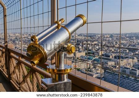 Tourist telescope in the Eiffel tower, Paris, France - stock photo