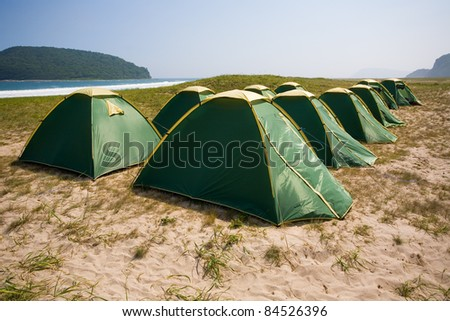 Tourist tent city on the seashore.