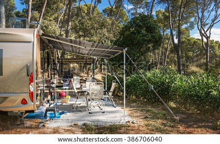 Tourist tent in forest camp among meadow - stock photo
