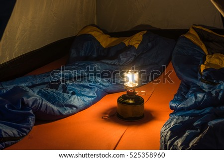 Tourist Tent Inside Small Camping Illuminated The Gas Lamp