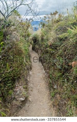 Tourist trail around Laguna Cuicocha lake in Ecuador - stock photo