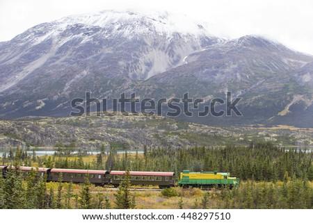 Tourist train going over White Pass, Alaska - stock photo