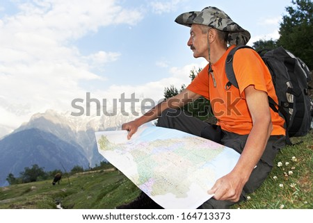 tourist traveller hiker with route map in Himalayas mountains