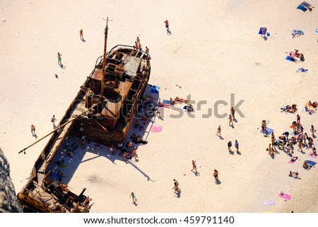 Tourist visiting Navagio Shipwreck Panagiotis in Zakynthos island, Greece. - stock photo