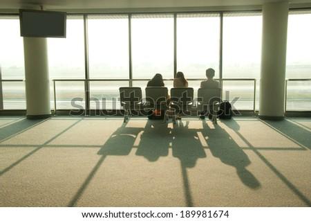 tourist waiting at airport terminal - stock photo