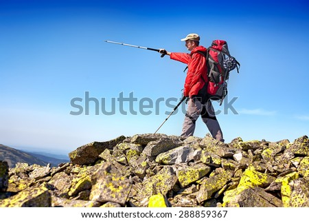 tourist with backpack on a mountain top in Carpathian