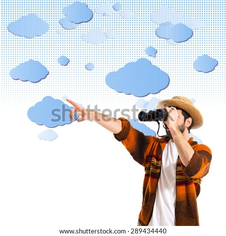 Tourist with binoculars over clouds background   - stock photo