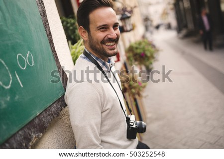 Tourist with camera enjoys sightseeing