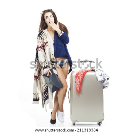 Tourist woman having problem with packing travel suitcase isolated white - stock photo