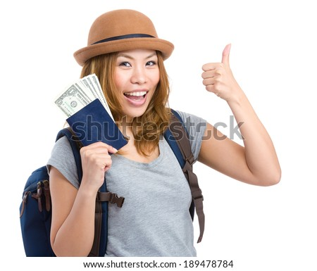 Tourist woman holding passport and money