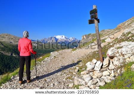 Tourist woman on mountain crossroads, Dolomite Alps, Italy - stock photo