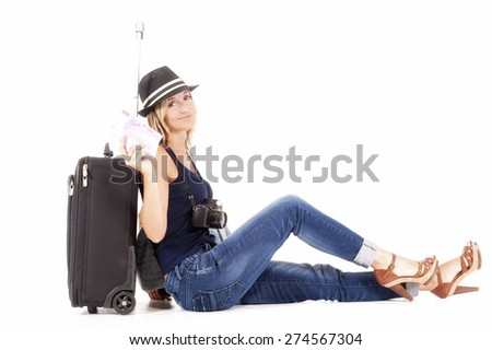 tourist woman traveling with her luggage and camera - stock photo