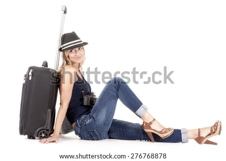 tourist woman traveling with her luggage and camera