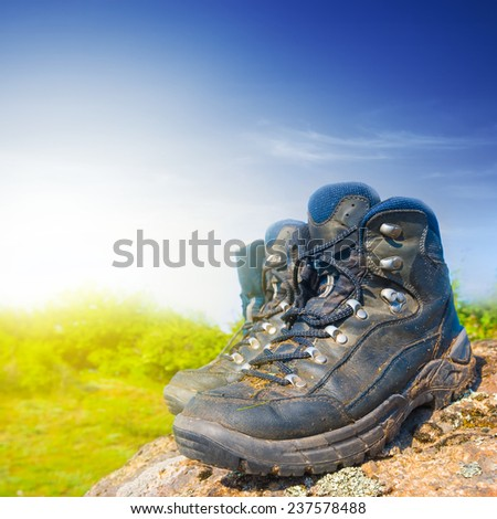 touristic boots on a stone - stock photo