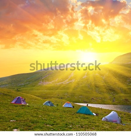 touristic camp in a mountains at the morning - stock photo