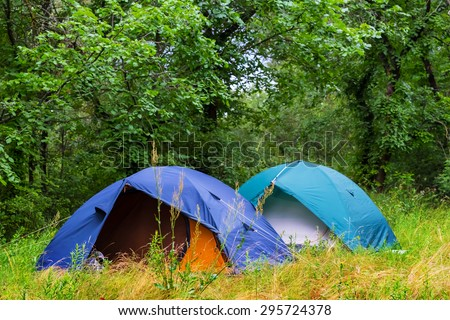 touristic camp in a summer forest - stock photo