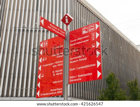 touristic red signpost in the center of Dortmund, Germany