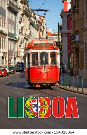 "Touristic red tram in a Lisbon street, with the word ""Lisbon"" with the Portuguese flag. - stock photo"