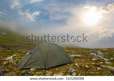 touristic stand on a mountain pass - stock photo