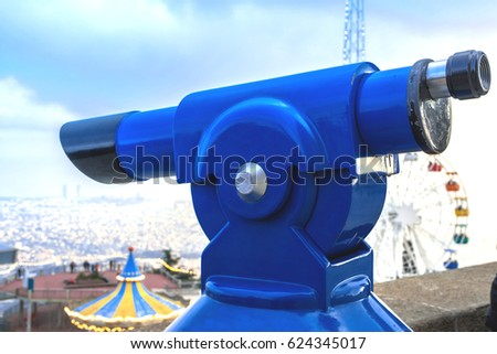 Touristic telescope look at the city with view of Barcelona Spain, close up old metal binoculars on background viewpoint overlooking city. Barcelona Tibidabo