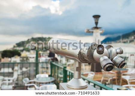 Touristic telescope look at the historical center of old town Quito , close up metal binoculars on background viewpoint overlooking the mountain. Quito is the second highest capital city in the world.