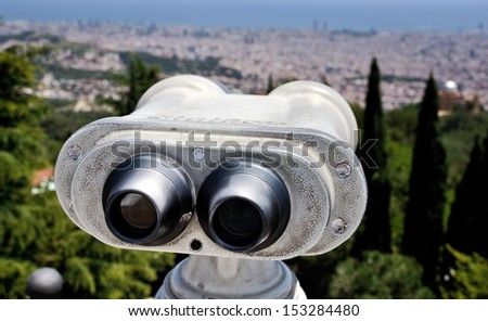 Touristic telescope with view of Barcelona, Spain from Mountain Tibidabo - stock photo