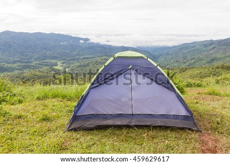 touristic tent among a green fields