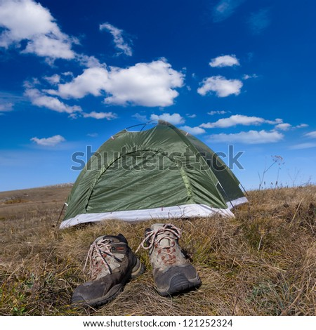 touristic tent and boots - stock photo