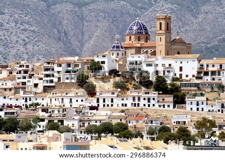 Touristic town of Altea and church with Sierra de Bernia mountain in the south east of Spain - stock photo