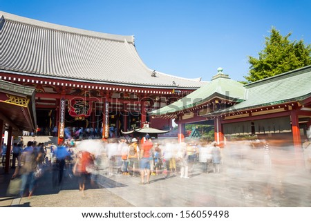Tourists and sightseers move around in a blur at Sensoji Temple in Tokyo, Japan.