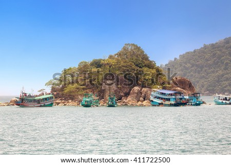 Tourists are enjoy snorkeling underwater at Koh Yak Lek (Island located near Koh Chang in Trat, Thailand) - stock photo
