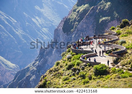 Tourists at the Cruz Del Condor viewpoint, Colca canyon, Peru - stock photo