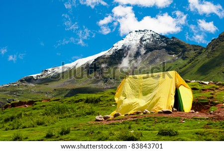 Tourists camping tent in mountains. Traveling background - stock photo