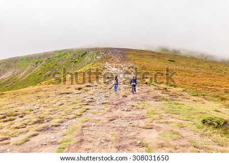 Tourists climb to the top of Hoverla in Carpathians - stock photo