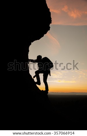 Tourists climbing silhouette at sunset for background. - stock photo