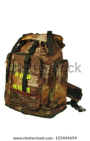 Tourists equipment. Green backpacking bags  on white background. Necessary articles for happy holidays. - stock photo