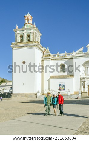 Tourists family in Basilica of Our Lady of Copacabana in Copacabana, Bolivia - stock photo