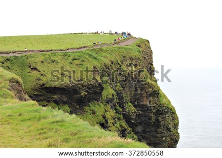 Tourists flock to the cliffs of Moher, Burren region, County Clare, Ireland - stock photo