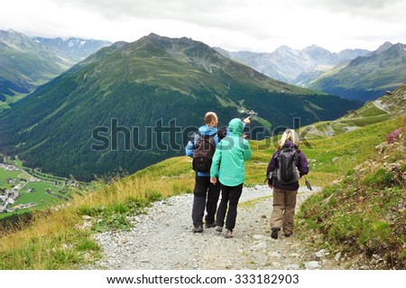 Tourists hiking in swiss mountains above Davos, Switzerland