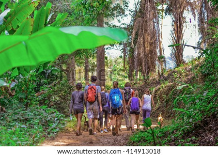 Tourists hiking in the deep jungle of the Khao Yai national park in Thailand , Asia - stock photo